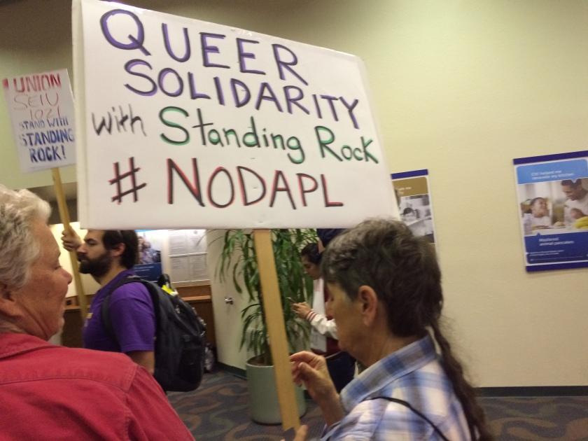 Queer Solidarity with Standing Rock, #No DAPL. Demonstrators invade Oakland bank lobby.