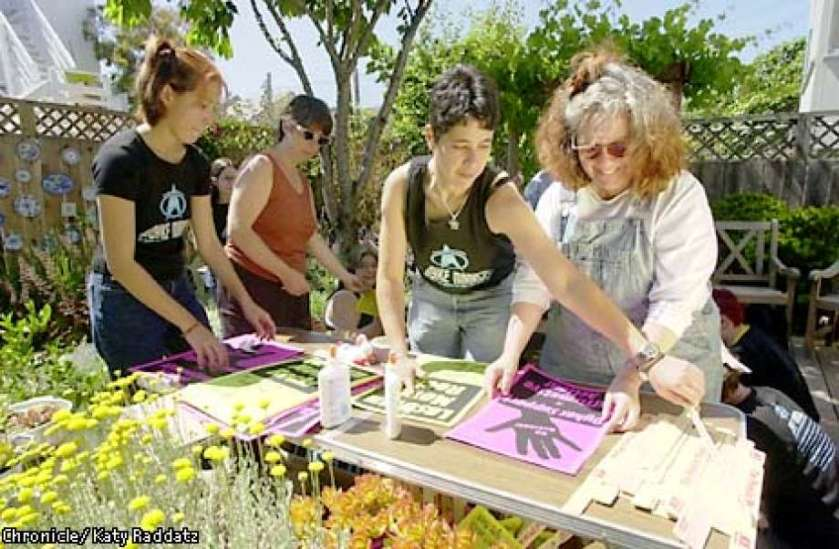 photo of women working on posters for the Dyke March